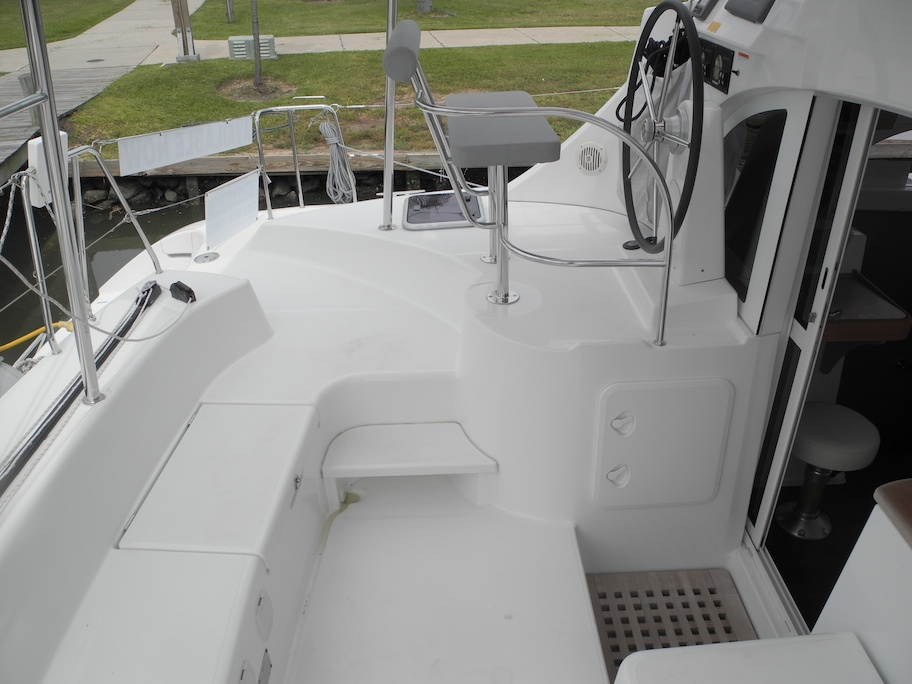 Cockpit Step to Helm and Storage Under Helm